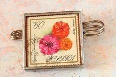 Dzikie Twory broszka ze znaczkiem pocztowym cynia